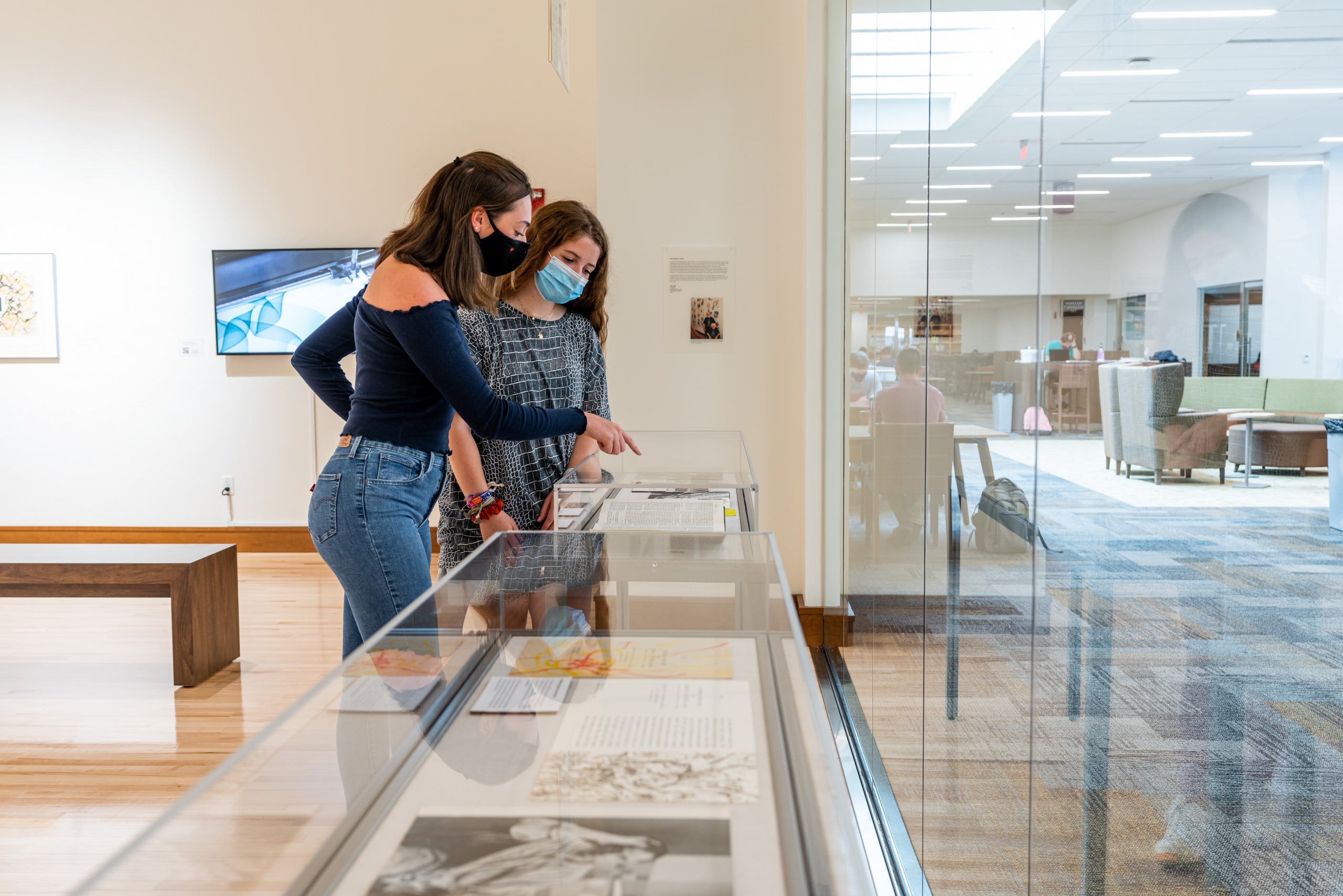 the people looking at a glass case in the Verostko gallery