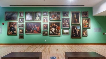 Wall of paintings at the Verostko Center