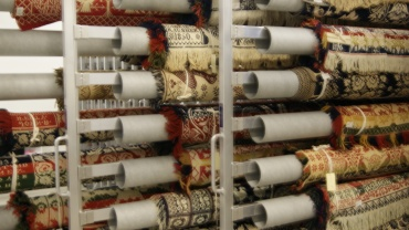 Many coverlets stored on rolls
