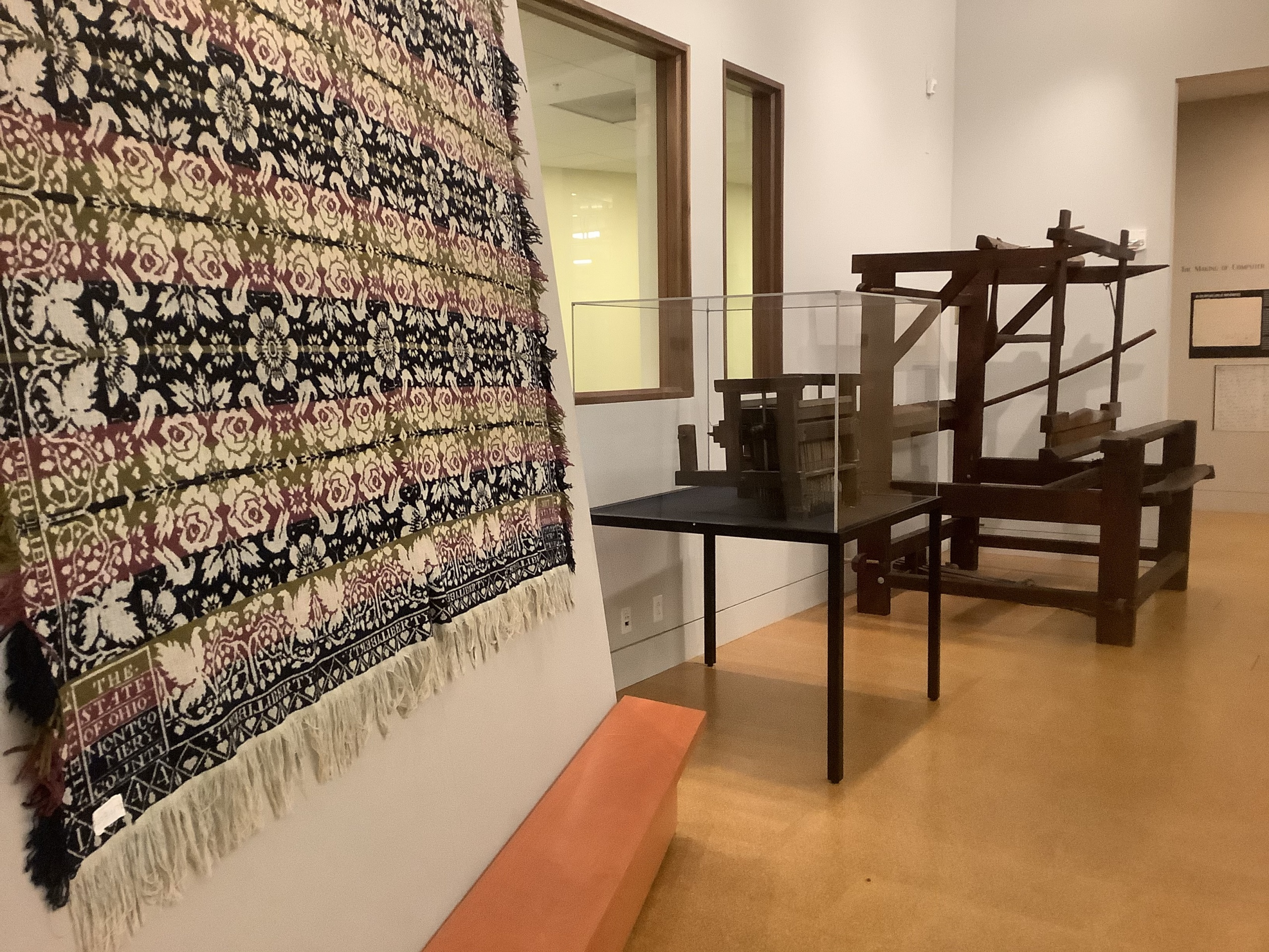 Exhibit with coverlets and loom at McCarl Gallery