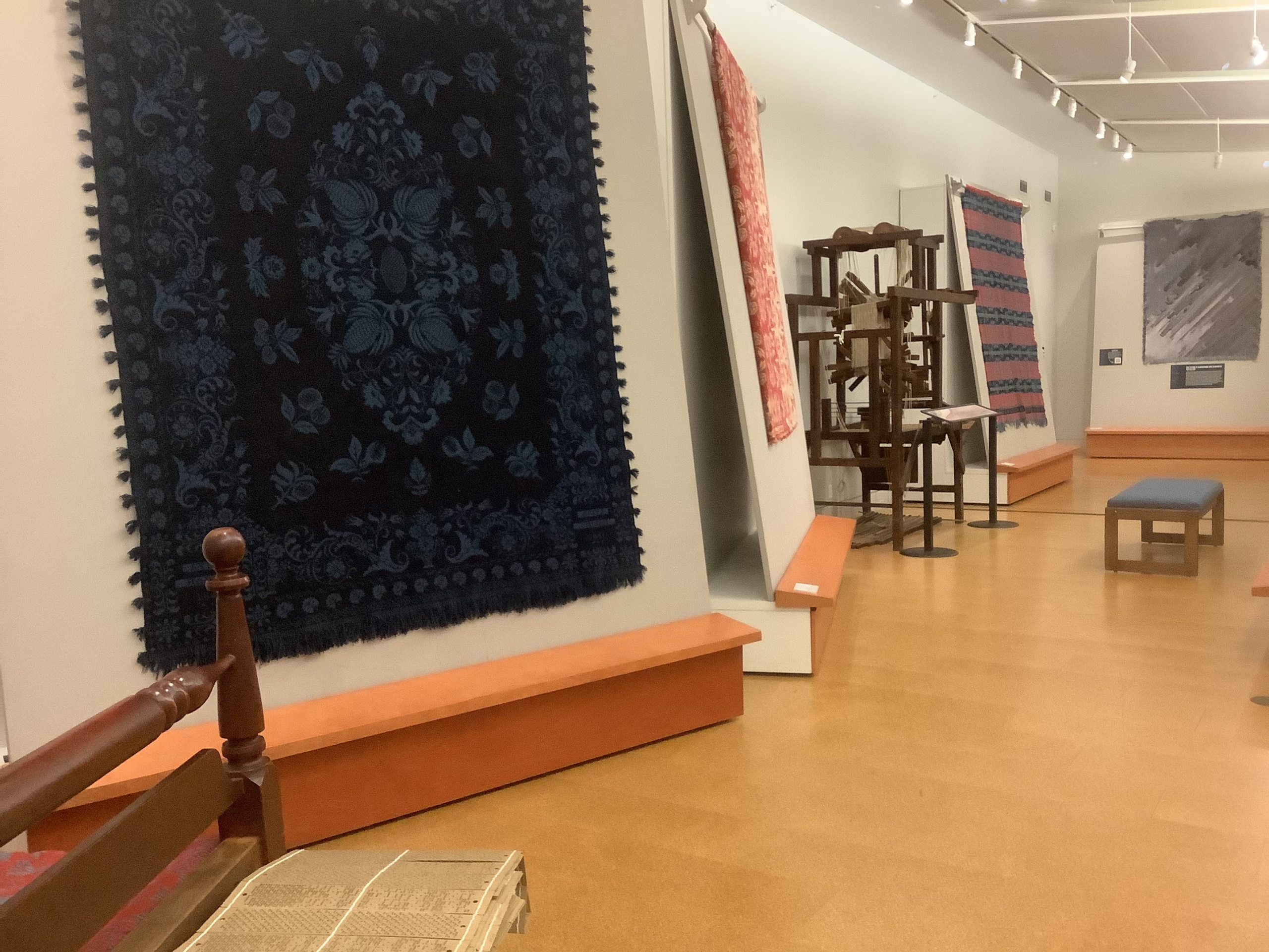 Exhibit with coverlets at McCarl Gallery
