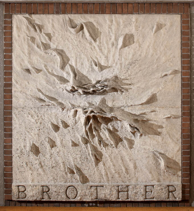 wall sculpture with the word Brother